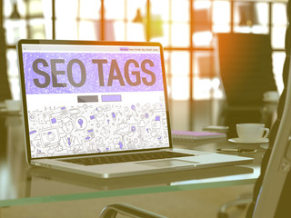 SEO Tags - Closeup Landing Page in Doodle Design Style on Laptop Screen. On Background of Comfortable Working Place in Modern Office. Toned, Blurred Image. 3D Render.