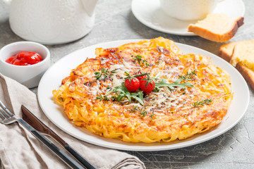 pasta casserole with eggs, sun-dried tomato and cheese
