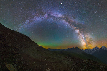Milky Way arc and stars over mountains