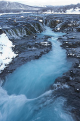 River flowing from waterfall, Bruarfoss, Sudhurland, Iceland