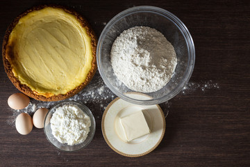 Homemade cheesecake with ingredients around.