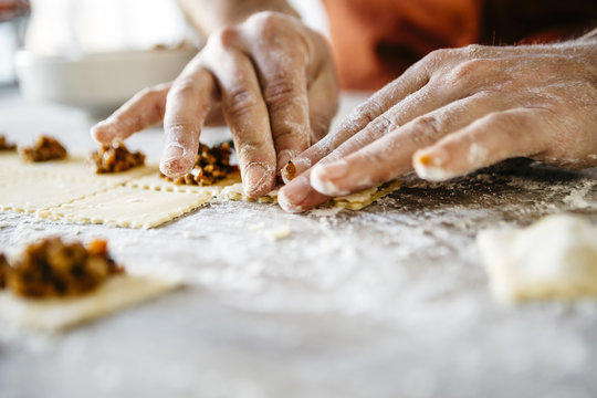 Making ravioli on a wooden table and tools