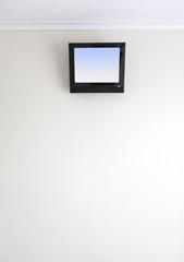 small TV on motel wall