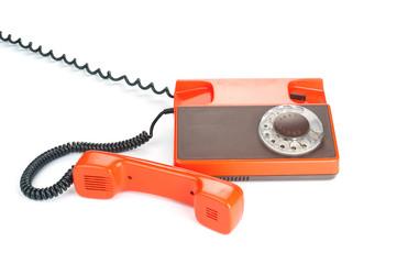 Retro rotary phone isolated on white