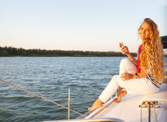 Summer woman on boat taking a picture