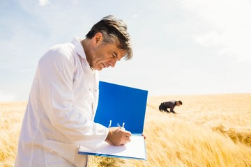 Agronomist writing in the file