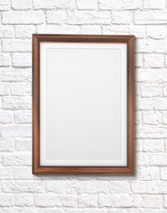 Classic wooden frame isolated on a brick wall