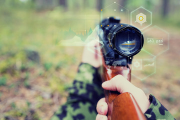 close up of soldier or sniper with gun in forest