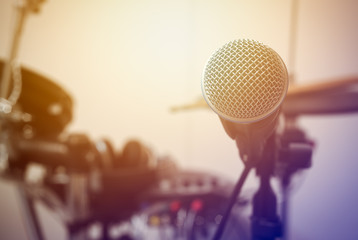 Microphone on blur drum and flare light background.