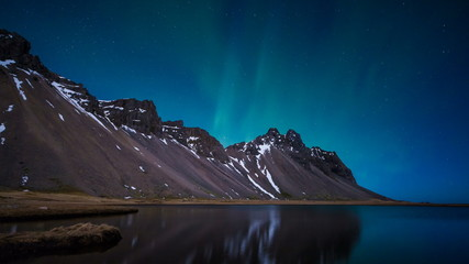 Wall Mural - Northern Lights above a mountain and lake