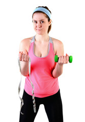 Sporty young woman with green dumbbell and measuring tape. isolated on a white background