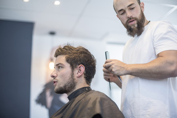Young man at barber's shop