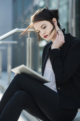 Portrait of young business woman using tablet computer