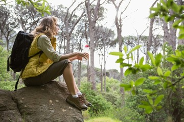 Woman sitting on a stone