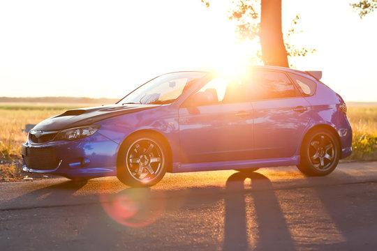 Left side view of blue sport car