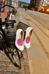 Bridal shoes on bicycle at street