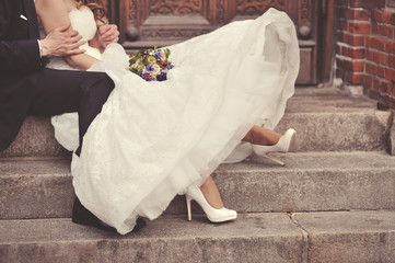 Happy bride and groom on steps of church in Copenhagen.
