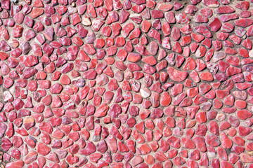 Red pebble on floor background