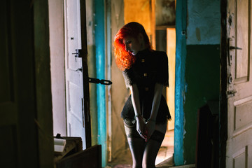 red-haired girl in handcuffs