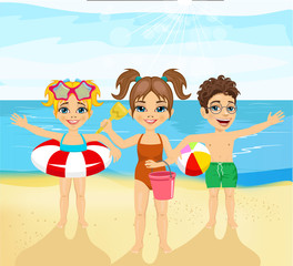 children with inflatable rings, ball, pail and shovel standing on the beach