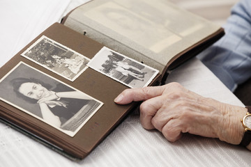 Senior woman watching old photographs of herself