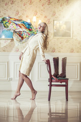 Female model in bright coat with a flying scarf and  pink lips i