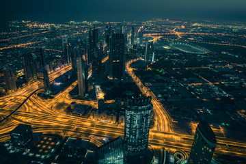 Dubai downtown night scene with city lights