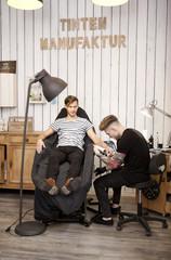 Tattooist at work in his tattoo studio