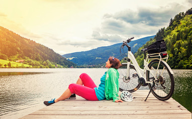 woman with e-bike resting beside a beautiful lake-e-power 17