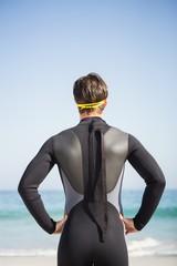 Man in wet suit posing