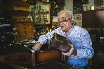 Watchmaker working in watchmaking
