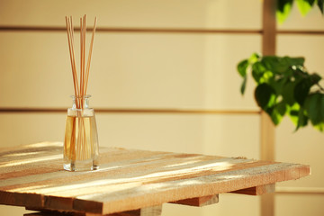 Handmade reed freshener on wooden table, close up