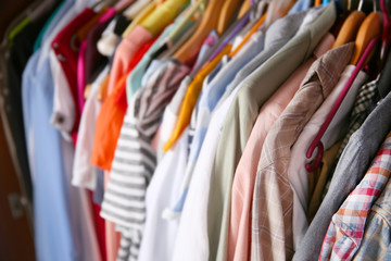 Clothes neatly hanging in the closet, close up