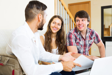 Young couple and salesman talking