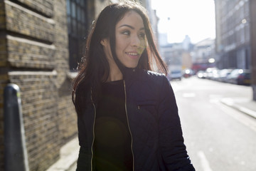 Portrait of attractive young woman on urban street