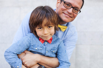 Father and son wearing bow ties, portrait