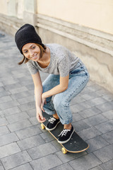 Portrait of smiling young female skate boarder