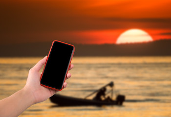 moblie phone on hand with nature background