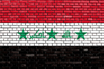 flag of Iraq painted on brick wall