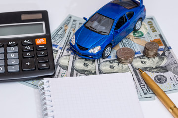 blue toy car, money, notepad