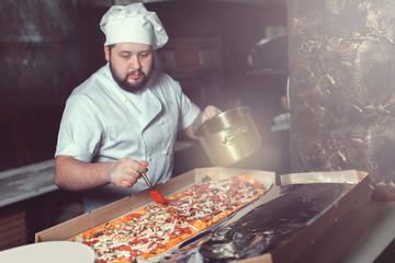 chef making pizza.