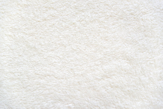Beige background of plush fabric