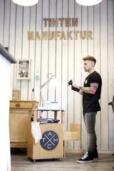 Tattooist in his tattoo studio