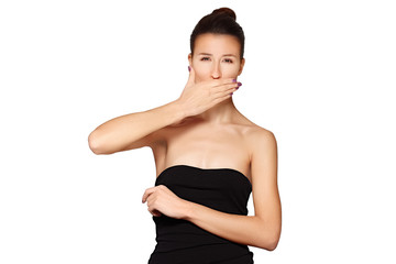 young lady closes her mouth with hand