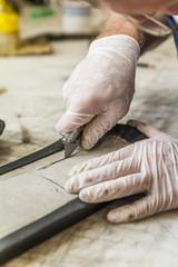 Saddler cutting padding for hippotherapy belt