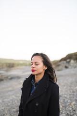 Spain, Ferrol, portrait of woman with closed eyes
