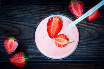 Glass of smoothie with strawberries