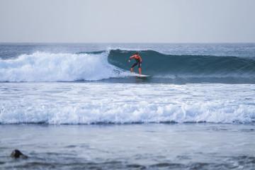 Spain, Tenerife, Boy surfing on ocean