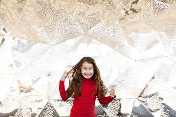 Portrait of smiling little girl in front of metal wall