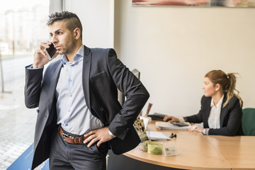 Businessman on the phone in office